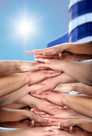 hands clasped under sun shine photo