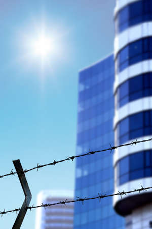 Barbed wire Fence and buildings  Stock Photo - 2037799