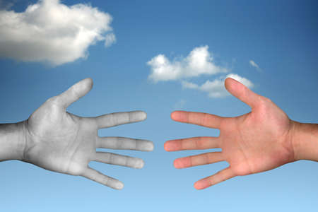 hands reaching each other over cloudy sky Stock Photo - 2354590