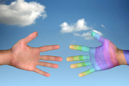 hands reaching each other over clear sky photo