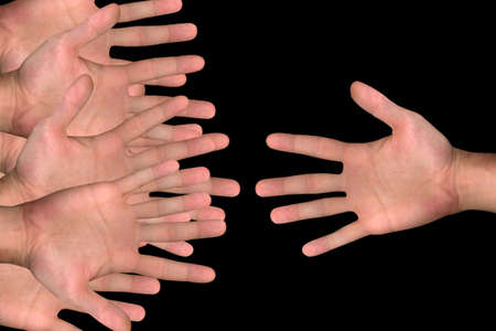 hands reaching each other over black background photo