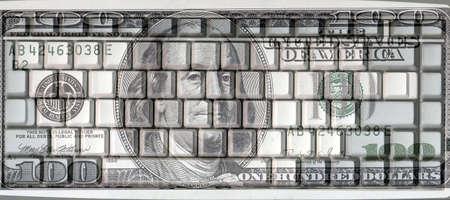 key board: close up shot of a key board and dollar bill