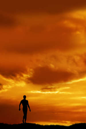 Man silhouetted by sunset  walking in nature Stock Photo - 3652234