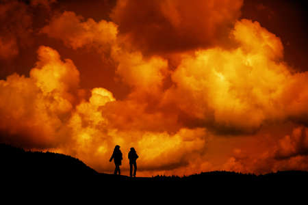 women silhouetted by sunset  walking in nature Stock Photo - 3759898