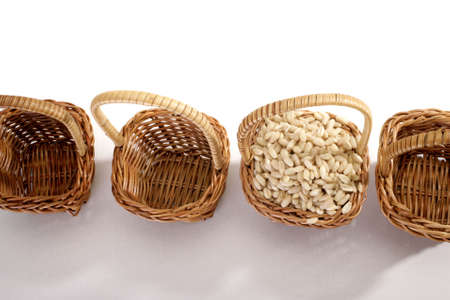 agronomic: wheat grain in a basket on white background