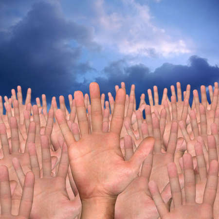 single hand in front of several hands on blue background Stock Photo - 3809604