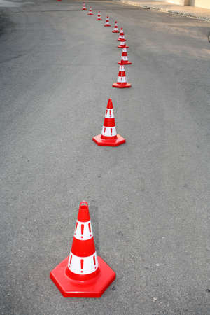 cautions: An image of cautions on asphalt road Stock Photo