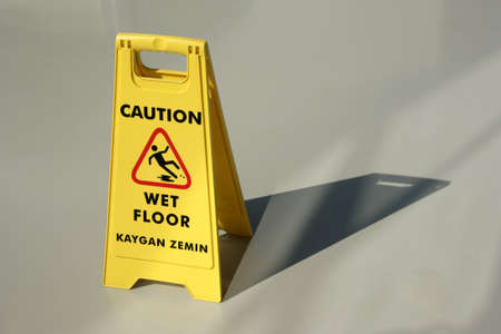 An image of yellow wet floor caution Stock Photo - 3871063
