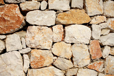 architectural detail shot of solid rock wall photo
