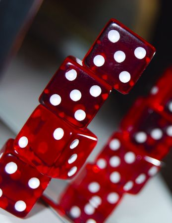 close ups: red dice close ups infront of a mirror on top of each other