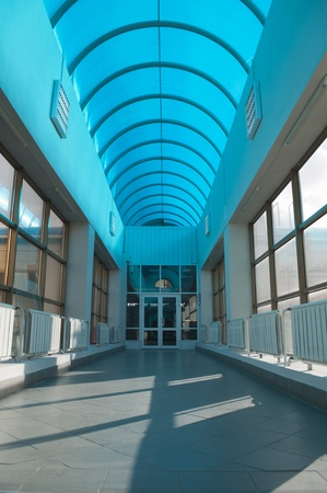high ceiling: Long hall with a cyan roof of polycarbonate Stock Photo