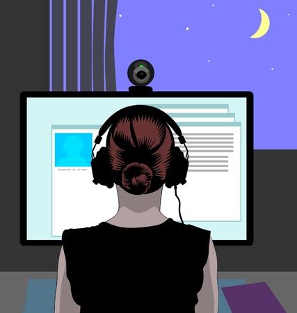 webcam: Woman communicating via web camera at night