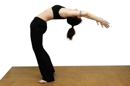 Woman practicing yoga backbend photo