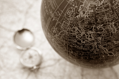 vintage world map: An ancient map of the world with a compass on the backgorund