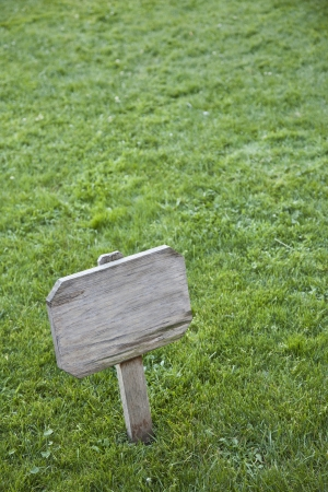 View of a sign on a green field