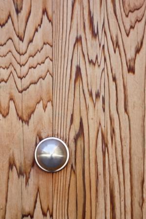 Metallic doorknob on a wooden door