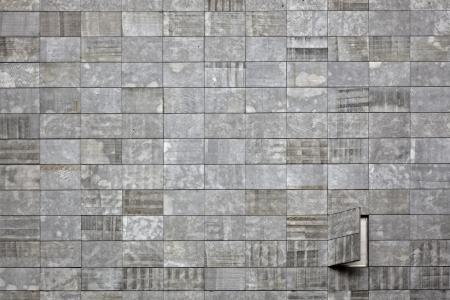 A windows on a stone cladding wall