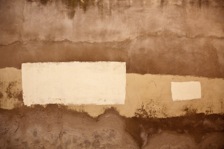 An old painted wall with different colours creating an artistic background