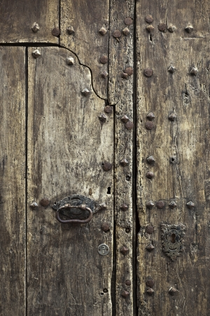 An old door at the village of Cadaques, Girona, Spain