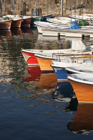 A group of fishing boats in the port of San Sebastian, Spain