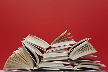 A group of books on red background Standard-Bild