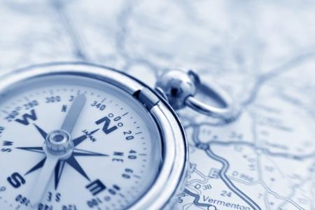 A compass on a road map Standard-Bild