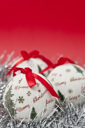 Christmas balls and decoration on red background