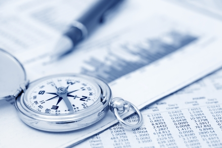 Compass and papers about financial issues Imagens