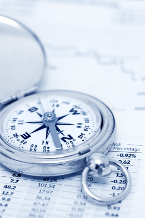 Compass and papers about financial issues