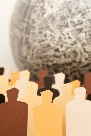 racial diversity: A group of diverse people with the Earth on the background  Focus on the central yellow figure