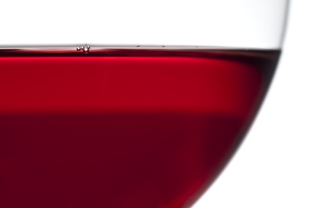 Detailed view of a red wine glass with little bubbles on surface Standard-Bild