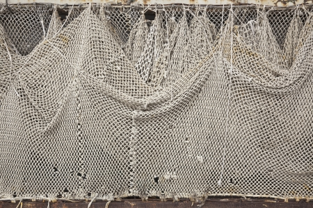 View of a white fishnet hung to dry