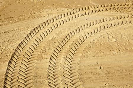 Wheel tracks on golden sand Standard-Bild