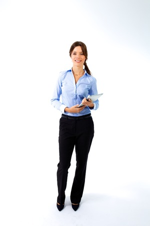 Full-length studio shot of a young businesswoman with a tablet isolated on white. photo