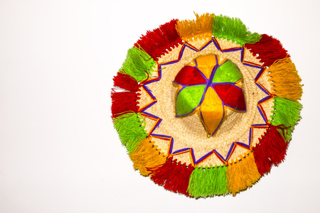 A single water man hat from Marrakech (Morocco) on a white background (isolated).  These hats are usually very colourful an traditional.  Horizontal Shot. photo