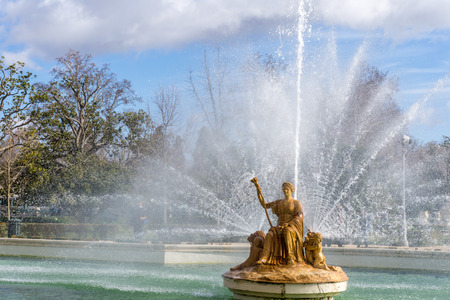 Beautiful big fountain with golden queen statue Stock Photo