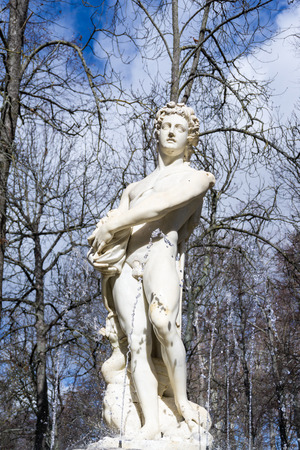 naked statue: Marble naked man statue on top of garden fountain Stock Photo