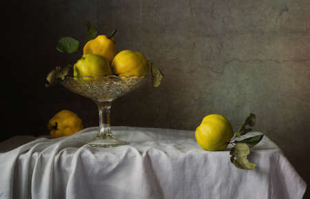 Still life of fruit bowl and fruit quince., painting for home or office, decoration of dishes. Shot using the 50 mm lens .