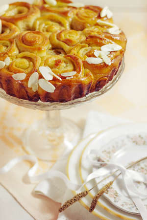 cake , white bread with yeast with almonds and caramel for dessert or coffee Stock Photo