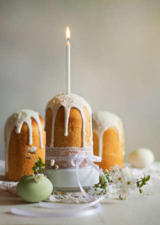 cake and candle, all for a holiday , flowers and eggs for a new life in the spring.