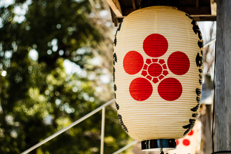 A Japanese lantern on display at a shrine in Tokyo, Japan. Stock Photo