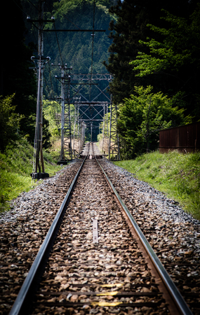 forest railroad: Clear traintrack leading towards the mountainous forests in Chichibu.