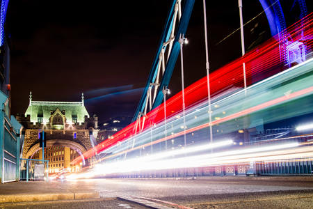 Traffic whizzing across Tower Bridge in London, the UK.