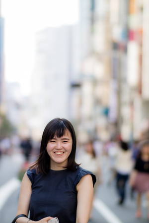 A beautiful Japanese Lady in the City Laughing