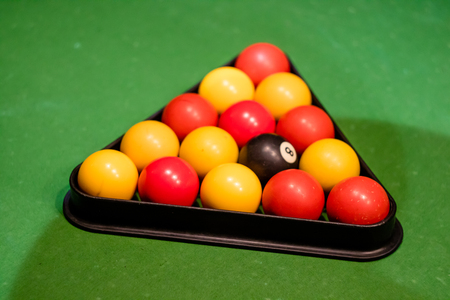 Pool balls set up in the triangle ready on the green cloth Stock Photo