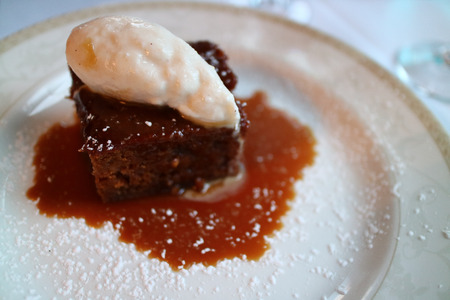 Sticky ginger pudding  with ice cream on top for dessert