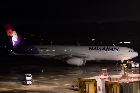 Tokyo, Japan - 08012017: A Hawaiian Airline Airbus A330-200 taxiing in preparation for Take-off at night in Narita Airport.