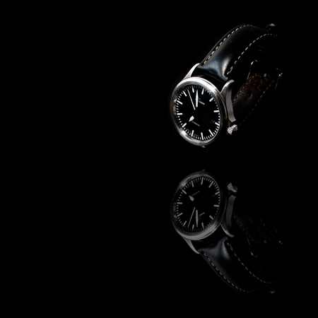 York, United Kingdom - 05172018: A well-worn Sinn 556 I automatic watch, made in Germany. Isolated on a black background.