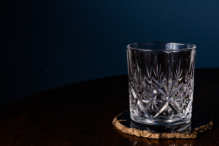 An empty crystal tumbler used normally used for whiskey 스톡 콘텐츠