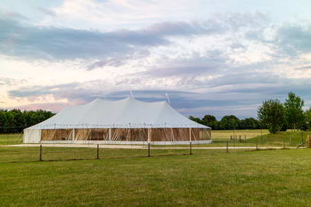 A marquee set up in a field in the evening for an event like a wedding or a party Standard-Bild